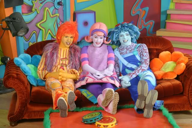 Deedee, Rooney and Moe from the Doodlebops sit on a couch